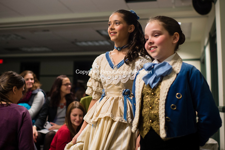 SOUTHBURY, CT - 20 November 2015-112015EC16--  Julianna Rodrigues, dressed as the Nutcracker's Clara, and Kate Rodrigues, as Fritz, weave through the crowd during an interactive Nutcracker performance with children who showed up at the Southbury Public Library Friday night. Members of the Main Street Ballet of Woodbury will perform the entire production December 5th and 6th at Pomperaug High School. Visit www.mainstreetballet.com for more information. Erin Covey Republican-American.
