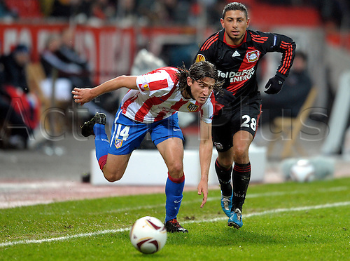 Leverkusen's Burak Kaplan (R) and Madrid's Luis Filipe challenge for the ball during the Europa League group B match between Bayer Leverkusen and Atletico Madrid at the BayArena in Leverkusen, Germany on 16. December 2010.