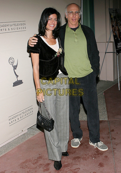 "LAURIE DAVID & LARRY DAVID.The Academy of Television & Sciences Activities Committee presents An Evening with ""Curb Your Enthusiasm"" held at the Academy's Leonard H. Goldenson Theatre, North Hollywood, California..USA, United States.9th November 2005.Ref:ADM/ZL.half length with together eye contact posed.www.capitalpictures.com.sales@capitalpictures.com.© Capital Pictures.."