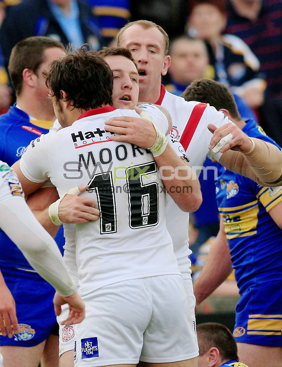 Pix: Chris Mangnall /SWPix.com, Rugby League, Super League. 24/04/10 St Helens Saints v Leeds Rhinos....picture copyright>>Simon Wilkinson>>07811267 706>>....St Helens's 3rd try scoreer James Roby (c) congratulated by Scott Moore and Nick Fozzard