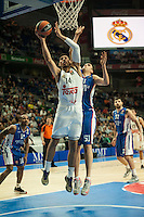 Real Madrid´s Gustavo Ayon and Anadolu Efes´s Milko Bjelica during 2014-15 Euroleague Basketball match between Real Madrid and Anadolu Efes at Palacio de los Deportes stadium in Madrid, Spain. December 18, 2014. (ALTERPHOTOS/Luis Fernandez) /NortePhoto /NortePhoto.com