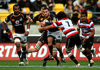 Wellington first five Fa'atonu Fili is tackled by Pepa Koloamatangi. ITM Cup - Wellington Lions v Counties-Manukau Steelers at Westpac Stadium, Wellington, New Zealand on Sunday, 8 August 2010. Photo: Dave Lintott/lintottphoto.co.nz.