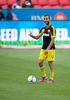July 20, 2013: Columbus Crew forward Justin Meram #9 during the warm-up in a game between Toronto FC and the Columbus Crew at BMO Field in Toronto, Ontario Canada.<br /> Toronto FC won 2-1.