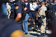 Cleveland, OH - July 20, 2016: An unidentified woman was among several people arrested during a skirmish that occurred between opposing protestors near 4th and Prospect streets during the Republican National Convention in downtown Cleveland, Ohio, July 20, 2016.  (Photo by Don Baxter/Media Images International)