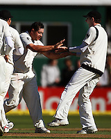 Iain O'Brien congratulates Jesse Ryder for dismissing Yuvraj Singh for 9 lbw during day one of the 3rd test between the New Zealand Black Caps and India at Allied Prime Basin Reserve, Wellington, New Zealand on Friday, 3 April 2009. Photo: Dave Lintott / lintottphoto.co.nz