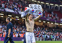 August 10, 2012..Jongwoo Park celebrates bronze medal match victory at the Millennium Stadium on day fourteen in Cardiff, England. Korea defeat Japan 2-0 to win Olympic bronze medal in men's soccer. ..