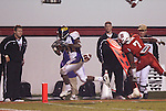 25 November 2006: East Carolina's Brandon Fractious (21) races past NC State's DaJuan Morgan (7) on a 12 yard touchdown run in the fourth quarter. The East Carolina University Pirates defeated the North Carolina State University Wolfpack 21-16 at Carter Finley Stadium in Raleigh, North Carolina in an NCAA Division I College Football game.
