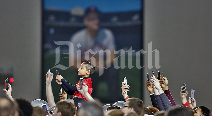 Sitting head and shoulders above the other camera phones, Robert Lathon, 6, gets some photos of the Ohio State Buckeye Football team practicing at the Woody Hayes Athletic Center on April 11, 2015.  He was sitting upon his father, Robert Lathon's shoulders at the fourth annual Student Appreciation Practice .  (Chris Russell/Dispatch Photo)