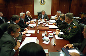 Washington, DC - September 20, 2001 -- United States President George W. Bush meets with his national security advisors in the Situation Room of the White House prior to addressing a Joint Session of Congress on September 20, 2001.  Left to right: CIA Director George J. Tenet;  Attorney General John Ashcroft; Secretary of the Treasury Paul O'Neill; Vice President Dick Cheney; President George W. Bush; Secretary of State Colin Powell; Secretary of Defense Donald Rumsfeld; Henry J. Shelton, Chairman, Joint Chiefs of Staff; Andy Card, White House Chief of Staff.  Deputy Secretary of Defense Paul Wolfowitz is at the far left of the photo..Mandatory Credit: Eric Draper - The White House via CNP