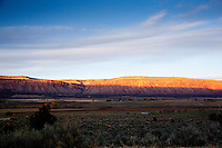 Sunset bathes the cliffs over Paradox Valley, Colorado