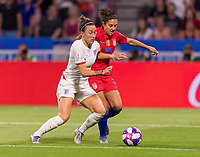 LYON,  - JULY 2: Lucy Bronze #2 defends Carli Lloyd #10 during a game between England and USWNT at Stade de Lyon on July 2, 2019 in Lyon, France.