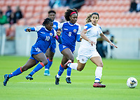 HOUSTON, TX - JANUARY 31: Raquel Rodriguez #11 of Costa Rica advances the ball with Nerilia Mondesir #10 and Danielle Etienne #8 of Haiti in pursuit during a game between Haiti and Costa Rica at BBVA Stadium on January 31, 2020 in Houston, Texas.
