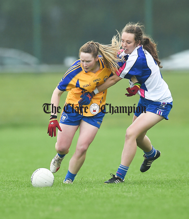 Ailish Considine of Clare in action against Megan Dunford of Waterford during their Munster Intermediate Football final at Mallow. photograph by John Kelly.