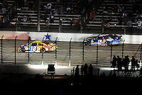 Nov. 8, 2009; Fort Worth, TX, USA; NASCAR Sprint Cup Series driver Kurt Busch (2) passes brother Kyle Busch (18) as he runs out of gas late in the Dickies 500 at the Texas Motor Speedway. Mandatory Credit: Mark J. Rebilas-