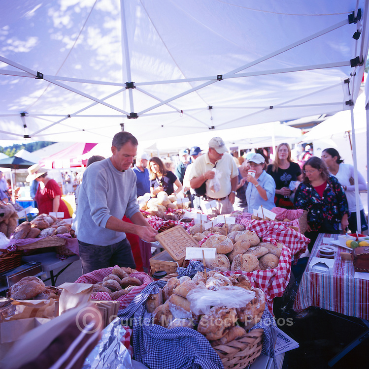 Artisan Baker selling Loaves of Bread at the Saturday Market in Ganges, on Saltspring Island, in the Southern Gulf Islands of British Columbia, Canada