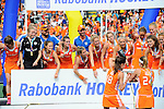 The Hague, Netherlands, June 14: Naomi van As #18 of The Netherlands and Eva de Goede #24 of The Netherlands fill the World Cup Trophy with champagne during the winner ceremony after the field hockey gold medal match (Women) between Australia and The Netherlands on June 14, 2014 during the World Cup 2014 at Kyocera Stadium in The Hague, Netherlands. Final score 2-0 (2-0)  (Photo by Dirk Markgraf / www.265-images.com) *** Local caption ***