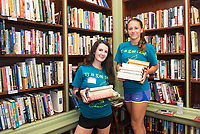 Emma Kiely,'21, and Claire Wulfman,'21, scan and organize books at the Redwood Library as they participate in the Salve Regina University Exploration Day of Service in Newport.