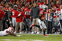 Ohio State Buckeyes quarterback Braxton Miller (5) scores on a touchdown run in the 1st quarter of their game against Clemson Tigers in the Discover Orange Bowl at Sun Life Stadium in Miami Gardens, Florida on January 3, 2014.(Dispatch photo by Kyle Robertson)