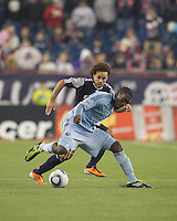 Sporting Kansas City midfielder C.J. Sapong (17) attempts to control the ball as New England Revolution defender Kevin Alston (30) pressures. In a Major League Soccer (MLS) match, the New England Revolution defeated Sporting Kansas City, 3-2, at Gillette Stadium on April 23, 2011.