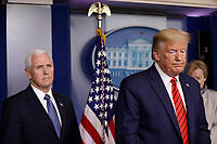 United States President Donald J. Trump and US Vice President Mike Pence (L) attend a press briefing on the Coronavirus COVID-19 pandemic with members of the Coronavirus Task Force at the White House in Washington on March 19, 2020. <br /> Credit: Yuri Gripas / Pool via CNP/AdMedia