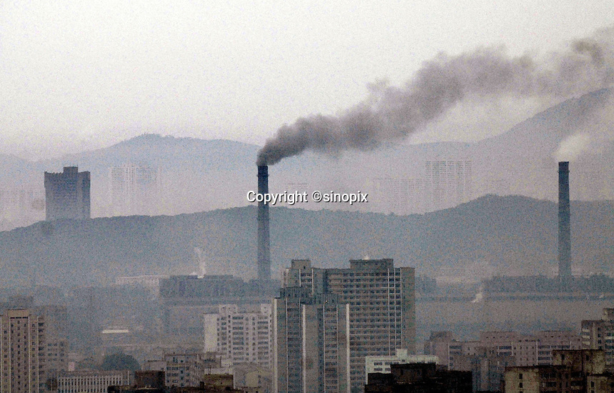 "Lots of smoke coming from factories in Pyongyang, North Korea. The DPRK (Democratic People's Republic of Korea) is the last great dictatorship where the people are bombarded with images of the ""Eternal President"" Kim Il-sung who died in 1994  and his son and current leader Kim Jong-il who are worshipped like a God."