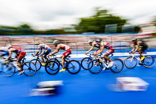 31.05.2014.  London, England.  A pan blur of action during the cycling leg of the ITU World Triathlon Elite Men's race being held in Hyde Park.