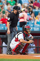 Nashville Sounds catcher Matt Pagnozzi (10) sets a target as home plate umpire Greg Stanzak gets into position during the game against the Oklahoma City RedHawks at Greer Stadium on July 25, 2014 in Nashville, Tennessee.  The Sounds defeated the RedHawks 2-0.  (Brian Westerholt/Four Seam Images)