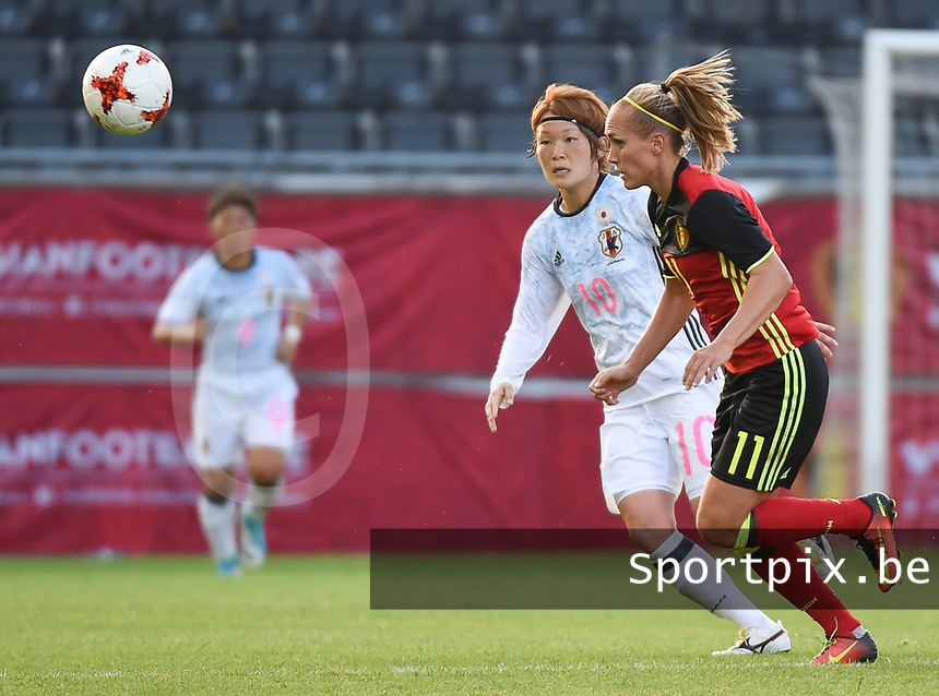 20170613 - LEUVEN ,  BELGIUM : Belgian Janice Cayman (R) and Japanese Mizuho Sakaguchi (L) pictured during the female soccer game between the Belgian Red Flames and Japan , a friendly game before the European Championship in The Netherlands 2017  , Tuesday 13 th Juin 2017 at Stadion Den Dreef  in Leuven , Belgium. PHOTO SPORTPIX.BE | DIRK VUYLSTEKE