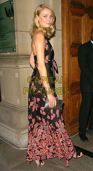 JODIE KIDD.British Fashion Awards held at the Victoria & Albert Museum, London..10th November 2005.UK, United Kingdom.Ref: CAN.full length black red patterned floor length dress plunging neckline curls curly wavy hair smiling posed.www.capitalpictures.com.sales@capitalpictures.com.©Capital Pictures
