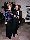 Actress Barbara Eden and Jon Eicholtz arrive at the White House in Washington, DC for the State Dinner honoring President Carlos Menem of Argentina on Thursday, November 14, 1991.<br /> Credit: Ron Sachs / CNP
