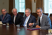 United States President Barack Obama shakes hands with U.S. Senate Majority Leader Harry Reid (Democrat of Nevada), during a meeting with Members of Congress on foreign policy in Cabinet Room of the White House in Washington, D.C., U.S., on Thursday, July 31, 2014. The U.S. might move to limit derivatives trading and short-term loans with Russian companies if sanctions already imposed fail to sway President Vladimir Putin of Russia to end support for rebels in eastern Ukraine.  From left to right: U.S. Senator Robert Menendez (Democrat of New Jersey), U.S. Senator Bob Corker (Republican of Tennessee), Senator Reid, and President Obama.<br /> Credit: Andrew Harrer / Pool via CNP