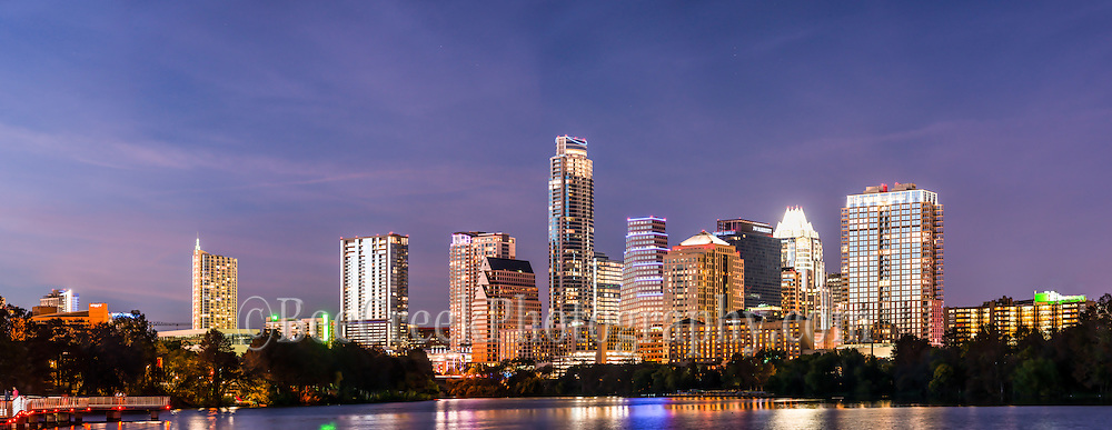 Austin Skyline Panorama at Twilight - We captured this Austin skyline panorama at twilight from along the Ladybird Lake hike and bike trail.   We thought the skyline with the high rise building were brilliant against the night sky with the Frost, Austonian, Four Season Hotel, Austin 360 and the W along with many others all crowding together along the shoreline.   You can see the reflection of the skyline in Ladybird lake but come back in a year or two and it will likely be different. The city skyline has been changing very fast over the last four or five years as new construction is popping up with high rise buildings almost every six or seven months in this town.