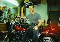 "COPY BY TOM BEDFORD<br /> Pictured: The Harley Davidson motorcycle once belonged to actor Patrick Swayze that was sold at auction<br /> Re: The iconic black leather jacket worn by Patrick Swayze in the hit film Dirty Dancing has sold for $50,000 (£38,612) at auction.<br /> It was bought by a fan after the tragic actor's wife decided to sell his movie memorabilia. <br /> The jacket had a reserve of just $6,000(£4,630) at the auction in Los Angeles but an internet bid of $25,000(£19,300) was received before the auction started.<br /> The salesroom erupted with applause when the hammer came down at $50,000.<br /> Auctioneer Darren Julien said: ""We always knew it would fetch big bucks.<br /> ""The jacket is the holy grail for Patrick Swayze fans and there are a lot out there.""  <br /> The heart throb actor wore the James Dean-style jacket throughout Dirty Dancing including the  scene where he says: ""Nobody puts Baby in a corner"".<br /> The jacket belonged to Swayze before the movie was made in 1987.<br /> Dirty Dancing was a low-budget movie and most of the clothes Swayze's wore were his own, including the leather jacket.<br /> Mr Julien said: ""Because it was his jacket he got to keep it after the movie and wore it whenever he felt like it."
