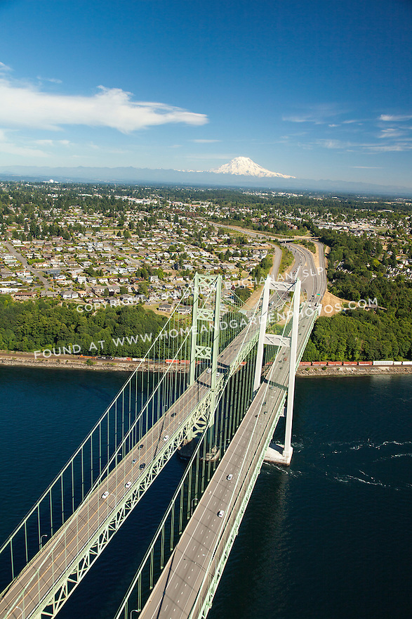 aerial view of Tacoma Narrows Bridge and Mount Rainier
