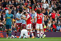 Tyrone Mings of Aston Villa and Granit Xhaka of Arsenal square up during the Premier League match between Arsenal and Aston Villa at the Emirates Stadium, London, England on 22 September 2019. Photo by Carlton Myrie / PRiME Media Images.