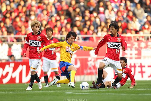 (L to R) .Yosuke Kashiwagi (Reds), .Makoto Kakuda (Vegalta), .Shuto Kojima (Reds), .MARCH 20, 2012 - Football /Soccer : .2012 J.LEAGUE Yamazaki Nabisco Cup .between Urawa Red Diamonds 1-0 Vegalta Sendai .at Saitama Stadium 2002, Saitama, Japan. .(Photo by YUTAKA/AFLO SPORT) [1040]