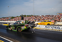 Jun 3, 2016; Epping , NH, USA; NHRA funny car driver Alexis DeJoria (near) races alongside teammate Del Worsham during qualifying for the New England Nationals at New England Dragway. Mandatory Credit: Mark J. Rebilas-USA TODAY Sports