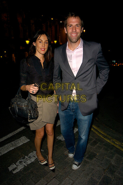 LUCY RUSEDSKI & GREG RUSEDSKI.Bad Girls The Musical - gala night, Garrick Theatre, London, England..September 13th, 2007.full length jeans denim grey gray jacket black bag purse blouse married husband wife .CAP/CAN.©Can Nguyen/Capital Pictures