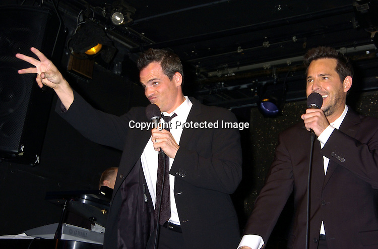 Michael Park and Ricky Paull Goldin..at The Goldin and Park Cabaret starring Ricky Paull Goldin from Guiding Light and Michael Park from As The World Turns. Kim Zimmer, Robert Newman and Mandy Bruno also sang. This was at The Triad NYC on April 16, 2005, and  was a benefit for Bill Runyon's family. ..Photo by Robin Platzer, Twin Images