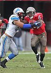 Detroit Lions linebacker DeAndre Levy (54) tries to tackle Tampa Bay Buccaneers running back Cadillac Williams (24) during an NFL football game between the Buccaneers and the Lions Sunday in Tampa, Fla, December 19, 2010. The Lions defeated the Buccaneers 23-20 in overtime. (AP/Margaret Bowles)