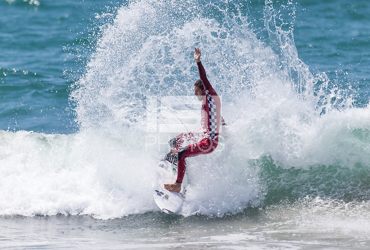 Huntington Beach, CA - Saturday August 4, 2018: Jorgann Couzinet in action during a World Surf League (WSL) Qualifying Series (QS) Men's Round of 16 heat at the 2018 Vans U.S. Open of Surfing on South side of the Huntington Beach pier.