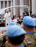 Papa Francesco saluta un gruppo di Caschi Blu dell'Onu al suo arrivo all'udienza generale del mercoledi' in Piazza San Pietro, Citta' del Vaticano, 3 febbraio 2016.<br /> Pope Francis waves to a group of UN's Blue Berets peacekeeping soldiers as he arrives for his weekly general audience in St. Peter's Square at the Vatican, 3 February 2016.<br /> UPDATE IMAGES PRESS/Riccardo De Luca<br /> <br /> STRICTLY ONLY FOR EDITORIAL USE
