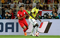 MOSCU - RUSIA, 03-07-2018: Davinson SANCHEZ (Der) jugador de Colombia disputa el balón con Jesse LINGARD (Izq) jugador de Inglaterra durante partido de octavos de final por la Copa Mundial de la FIFA Rusia 2018 jugado en el estadio del Spartak en Moscú, Rusia. / Davinson SANCHEZ (R) player of Colombia fights the ball with Jesse LINGARD (L) player of England during match of the round of 16 for the FIFA World Cup Russia 2018 played at Spartak stadium in Moscow, Russia. Photo: VizzorImage / Julian Medina / Cont