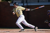 Dustin Hood (21) of the Wake Forest Demon Deacons follows through on his swing versus the Clemson Tigers during the second game of a double header at Gene Hooks Stadium in Winston-Salem, NC, Sunday, March 9, 2008.