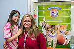 Wantagh, New York, USA. February 7, 2016. SUZANNE FERRARA, with her face painted, and her mother STACY FERRARA, of Plainview, are having fun at Last Hope Animal Rescue's Open House, during Hallmark Channel Kitten Bowl III. The adoption center's volunteers, including Stacy, and visitors watched the game on TV and cheered on their team, the Last Hope Lions. Over 100 adoptable kittens from Last Hope Inc and North Shore Animal League America participated in the taped games, and the Home and Family Felines won the 2016 championship, which first aired the day of Super Bowl 50.