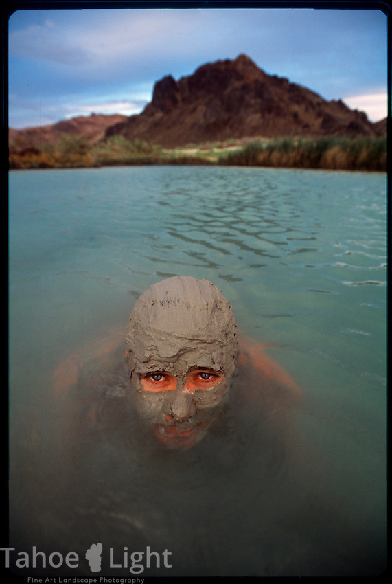 A man plays in the mud at Black Rock Hot Springs