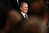 Former US president George W. Bush smiles during a service for former US President George H.W. Bush at the US Capitol at the State Funeral in Washington, DC, December 3, 2018. - The body of the late former President George H.W. Bush travelled from Houston to Washington, where he will lie in state at the US Capitol through Wednesday morning. Bush, who died on November 30, will return to Houston for his funeral on Thursday. (Photo by Brendan Smialowski / AFP)