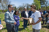 NWA Democrat-Gazette/BEN GOFF @NWABENGOFF<br /> Huxley Richardson (right), a junior in the Fayetteville High School Ambassadors, hands out commemorative vials of soil to Jeff Glover with Veterans Health Care System of the Ozarks, and wife Deja Glover with 7Hills Center Friday, April 12, 2019, during a groundbreaking ceremony for the New Beginnings facility in Fayetteville.