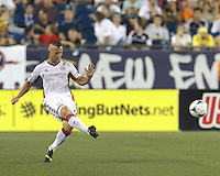 New England Revolution midfielder Chad Barrett (9) passes the ball.  In a Major League Soccer (MLS) match, the New England Revolution (white) defeated San Jose Earthquakes (black), 2-0, at Gillette Stadium on July 6, 2013.