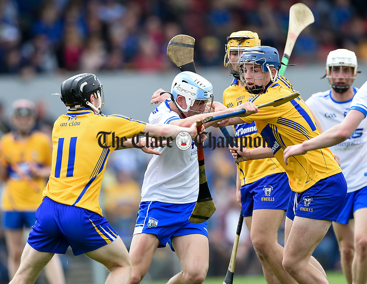 Rory Furlong of Waterford  in action against Gearoid O Grady and Jack Minogue of Clare during their Munster  championship round robin game at Cusack Park Photograph by John Kelly.